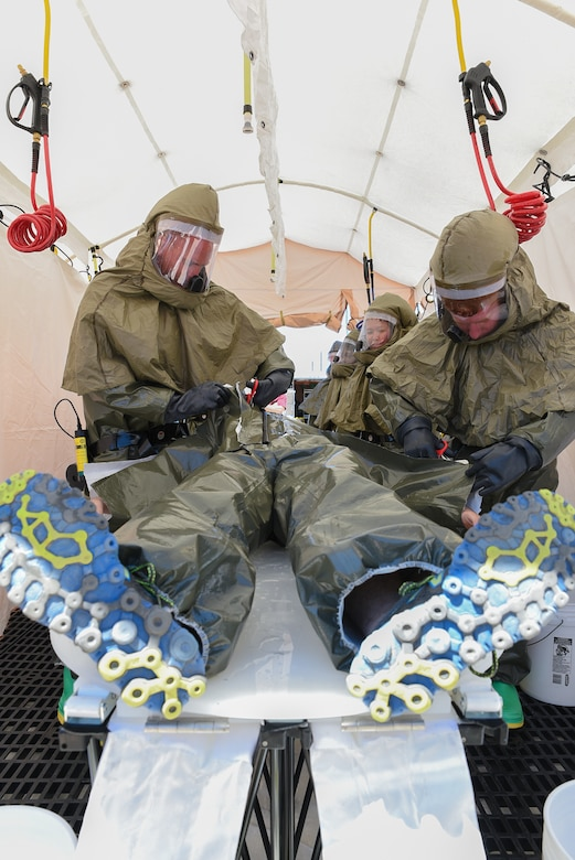 Airmen assigned to the 153rd Medical Group, decontaminate a simulated chlorine contaminated victim, June 19, 2015, at Cheyenne Air National Guard Base in Cheyenne, Wyo. The medical group is participating in Counter-CBRN All-Hazard Management Response (CAMR) training with civilian and military first responders to practice chemical, biological, radiological, first response, medical, and incident command scenarios for possible threats in the region. (U.S. Air National Guard photo by Master Sgt. Charles Delano)