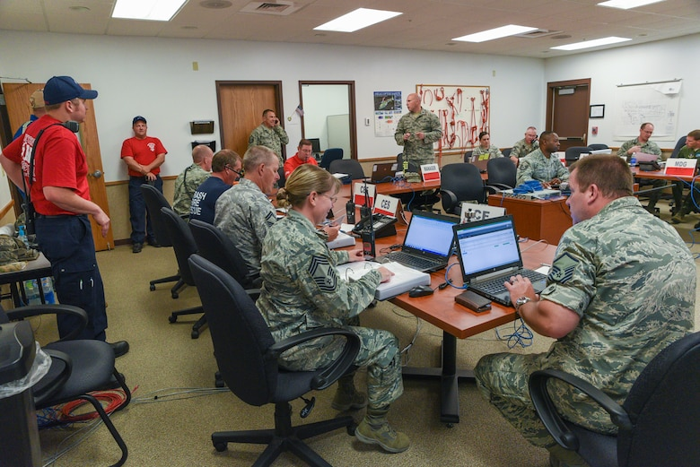 Airmen assigned to the 153rd Airlift Wing Wyoming Air National Guard stand up the emergency operations center in response to a simulated chlorine plume, June 19, 2015, at Cheyenne Air National Guard base in Cheyenne, Wyo. Civilian and military emergency responders are participating in Counter-CBRN All-Hazard Management Response (CAMR) training which provides instruction on chemical, biological, radiological, first response, medical, and incident command for possible threats in the region. (U.S. Air National Guard photo by Master Sgt. Charles Delano)