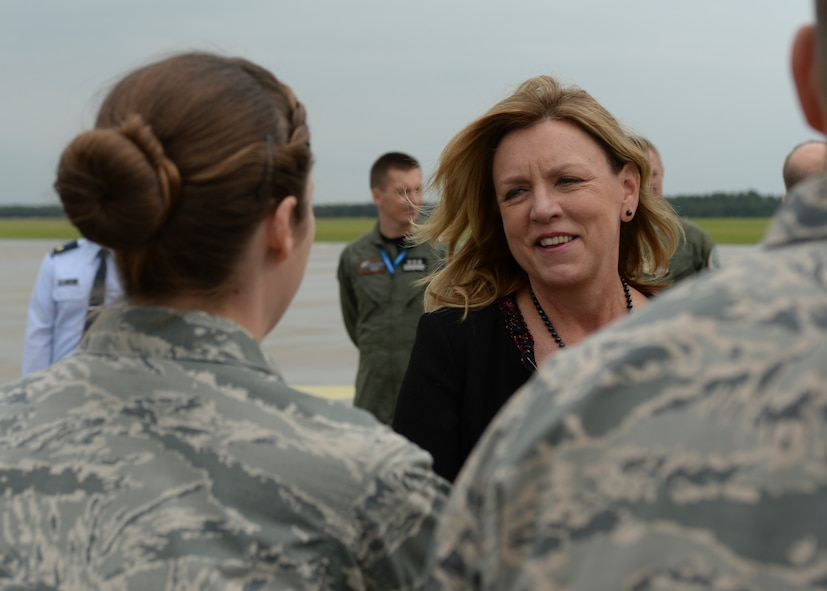 Deborah Lee James, Secretary of the U.S. Air Force, speaks with a U.S. Air Force Airman during a visit to Lask Air Base, Poland, June 22, 2015. The Secretary completed a visit of installations through Europe June 24, 2015, to meet Airmen, community leaders and allied and partner nation defense chiefs. (U.S. Air Force photo by Staff Sgt. Joe W. McFadden/Released)
