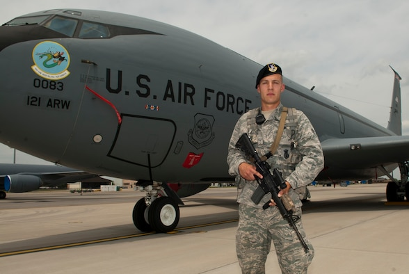 U.S. Air Force Airman 1st Class Joseph T. Nenadich, with the 121st Security Forces Squadron, poses with a KC-135 Stratotanker June 7, 2015 at Rickenbacker Air National Guard Base, Ohio. Nenadich, a 21-year-old from Youngstown, joined the Air National Guard in 2013. (U.S. Air National Guard photo by Tech. Sgt. Zachary Wintgens/Released)