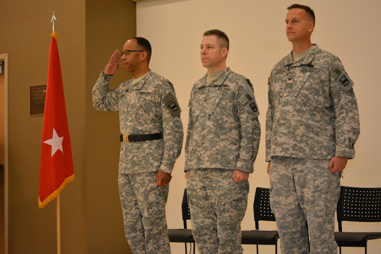 From left to right, Maj. Gen. A.C. Roper, commander 80th Training Command (TASS), Col. Howard C. W. Geck, outgoing commander, 800th Logistics Support Brigade, and incoming commander Col. Bradly M. Boganowski during a change of command ceremony Mustang, Okla., June 28, 2015.