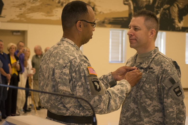 Maj. Gen. A.C. Roper, commander 80th Training Command (TASS), awards the Meritorious Service Medal to Col. Howard C. W. Geck, former commander 800th Logistics Support Brigade during a change of command ceremony Mustang, Okla., June 28, 2015. Col. Bradly M. Boganowski replaced Geck as commander.