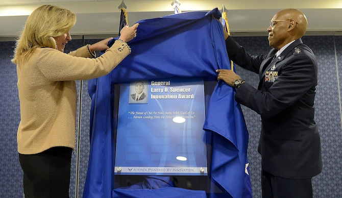 Secretary of the Air Force Deborah Lee James and Air Force Vice Chief of Staff Gen. Larry O. Spencer pull the shroud during the ceremonial unveiling of the Gen. Larry O. Spencer Innovation Award, named in Spencer's honor, June 29, 2015, at the Pentagon. The idea was conceived by Air Force Chief of Staff Gen. Mark A. Welsh III to recognize Airmen who share their creative and efficient ways to save money and time. (U.S. Air Force photo/Scott M. Ash)