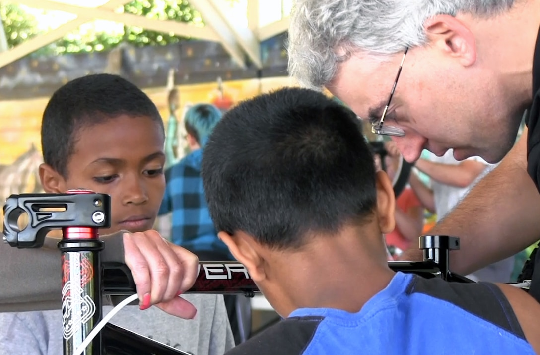 Mike Turaski, Portland District project manager, and other Corps employees were at the Native American Youth and Family Center recently where they taught kids to use engineering and math skills to build BMX bikes and understand why tire pressure makes a difference in racing performance.