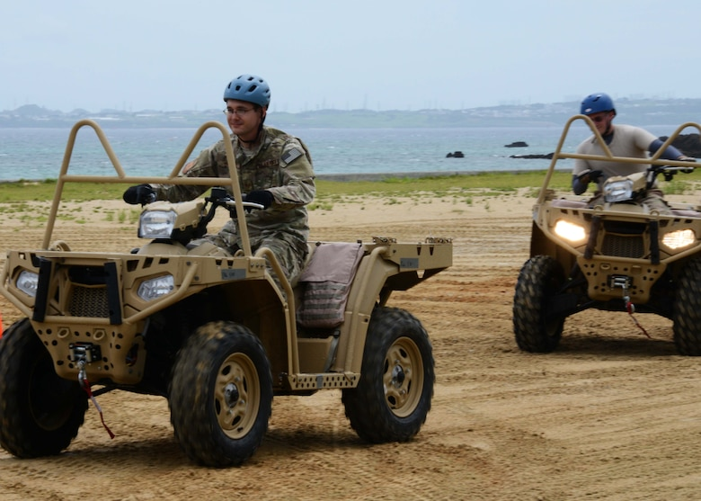 Two Gold Team members from the 320th Special Tactics Squadron Gold Flight, receive all-terrain vehicle qualification training during exercise Gold Thunder 2.0 at Camp Hansen, Japan, June 23, 2015.  It is necessary for members to be able to cover more ground on the quad when securing the area.  Gold Thunder 2.0 is a humanitarian assistance/disaster relief scenario exercise put together to train the combat mission support personnel in land and water navigation, establishing a special tactics operations center and a forward operating logistics hub along with other skills such as all-terrain vehicle qualification training, Krav Maga training and exfiltration capabilities with rotary wing aircraft. (U.S. Air Force photo by Tech. Sgt. Kristine Dreyer)  (U.S. Air Force photo by Tech. Sgt. Kristine Dreyer, 353rd SOG PA/Released)