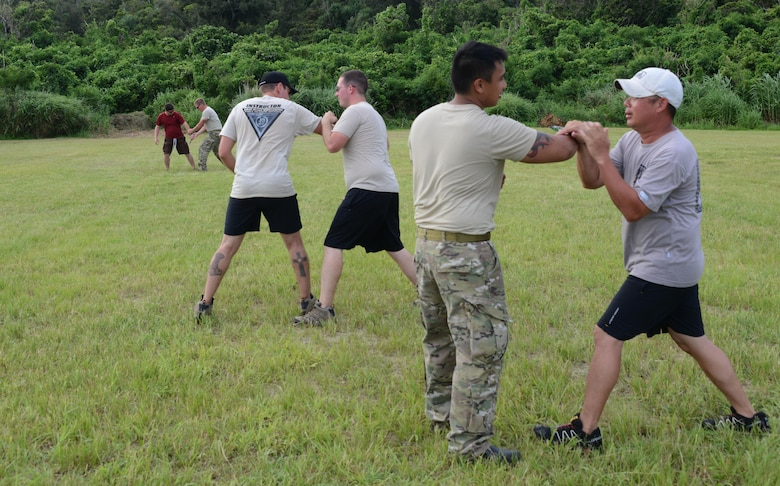 Members from 320th Special Tactics Squadron Gold Team, receive Krav Maga training during exercise Gold Thunder 2.0 at Camp Hansen, Japan, June 23, 2015.  Gold Thunder 2.0 is a humanitarian assistance disaster relief scenario exercise put together to train the combat mission support personnel in land and water navigation, establishing a special tactics operations center and a forward operating logistics hub along with other skills such as all-terrain vehicle qualification training, Krav Maga training and exfiltration capabilities with rotary wing aircraft. (U.S. Air Force photo by Tech. Sgt. Kristine Dreyer)