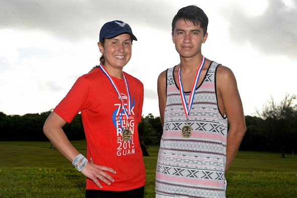 Meara McCarthy and Isaec Ventura, race participants, stand together after the Red, White and Blue 5K July 1, 2015, at Andersen Air Force Base, Guam. McCarthy took first place for the females with a time of 20 minutes, 41 seconds and Ventura took first place for the males with a time of 19 minutes, 3 seconds. (U.S. Air Force photo by Senior Airman Katrina M. Brisbin/Released)