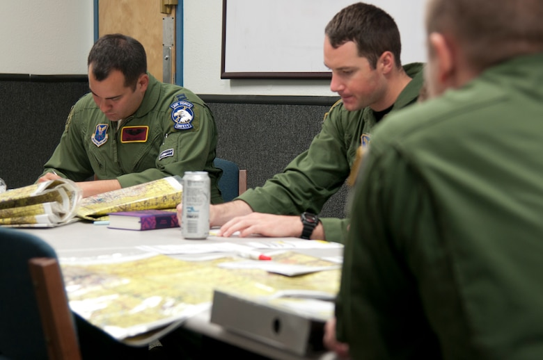 Capt. Michael Carter, 582nd Helicopter Group flight safety officer, fills out his Operational Risk Management forms prior to his flight. The ORM is a mandatory form that ensures the crew is prepared for a flight by having the crew conduct self-checks of their ability to perform the flight. (U.S. Air Force photo by Airman 1st Class Malcolm Mayfield)