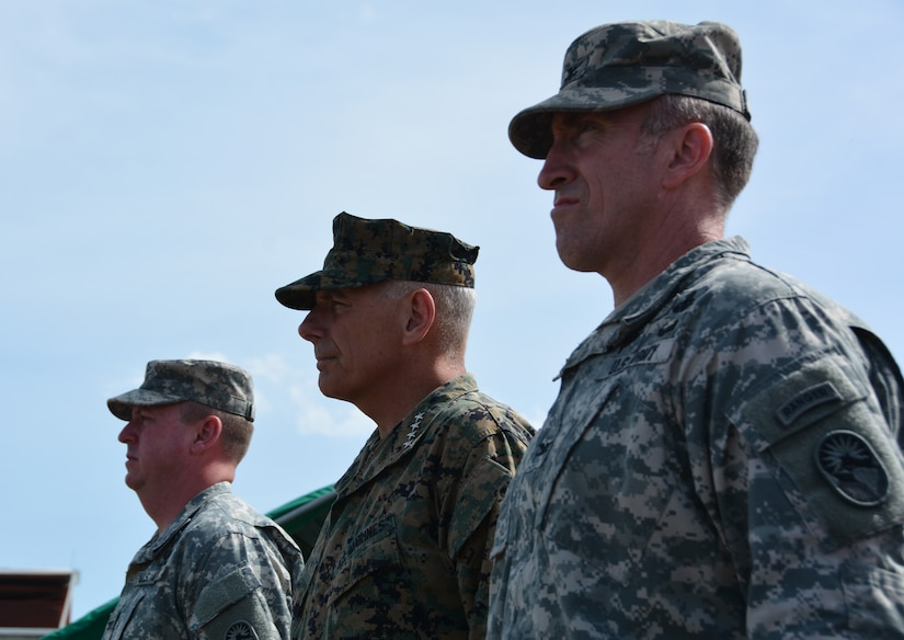 From left to right, Col. Kirk Dorr, JTF-Bravo outgoing commander, Gen. John Kelly, U.S. Southern Command commander, and Col. Robert Harman, Joint Task Force – Bravo incoming commander, inspect the formation during a change of command ceremony June 30, 2015, at Soto Cano Air Base, Honduras. Kelly presided over the ceremony, during which Dorr relinquished command to Harman, an Army Ranger with 24 years of service. (U.S. Air Force photo by Martin Chahin)
