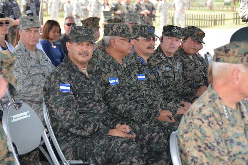 Maj. Gen. Fredy Diaz, Chief of the Joint Staff for the Honduran Armed Forces, sits with senior leaders from the Honduran Armed Forces at the Joint Task Force – Bravo change of command ceremony June 30, 2015 at Soto Cano Air Base, Honduras. Numerous senior leaders attended the ceremony, from both the U.S. and Honduras. (U.S. Air Force photo by Martin Chahin)