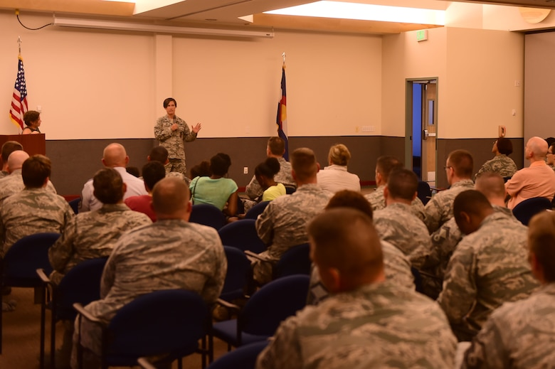 Lt. Col. Cynthia Clefisch, 460th Civil Engineer Squadron commander, speaks about her experiences as a lesbian in the military at the Pride Month closing ceremony June 29, 2015, on Buckley Air Force Base, Colo. As keynote speakers, Clefisch and her wife, Karissa Arnett, talked about the difficulties of being a gay couple in the military. (U.S. Air Force photo by Airman 1st Class Luke W. Nowakowski/Released)