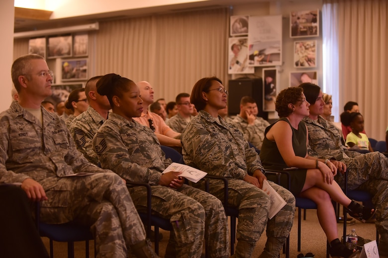 Base leadership attends the closing ceremony for Pride Month June 29, 2015, on Buckley Air Force Base, Colo. The ceremony included keynote speakers Lt. Col. Cynthia Clefisch, 460th Civil Engineer Squadron commander, and her wife, Karissa Arnett. (U.S. Air Force photo by Airman 1st Class Luke W. Nowakowski/Released)