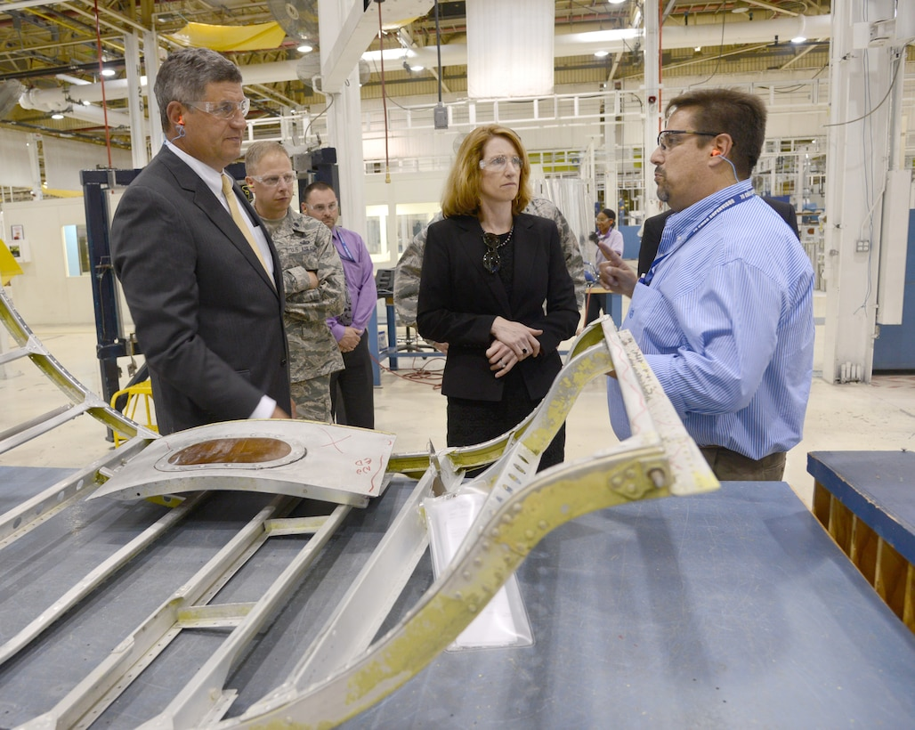 David Deal, with the 551st Commodities Maintenance Squadron, briefs the Honorable William LaPlante, Assistant Secretary of the Air Force (Acquisitions) (far left), and The Honorable Lisa Disbrow, the Acting Under Secretary of the Air Force and the Assistant Secretary of the Air Force for Financial Management and Comptroller (center), on how modular flow has increased cost-effective readiness in the B-52 Wrap Cowls shop.  The two senior leaders visited several Oklahoma Air Logistics Complex work centers as part of the visit to the AFSC here on Monday. U.S. Air Force photo by Kelly White.