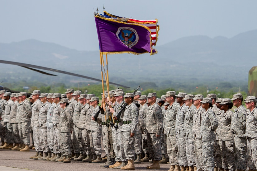 "The Joint Task Force – Bravo change of command formation stands at ""Parade Rest"" prior to the start of the Task Force's change of command ceremony June 30, 2015, at Soto Cano Air Base, Honduras. Hundreds of service members participated in the change of command ceremony, in which Col. Kirk Dorr relinquished command to Col. Robert Harman, JTF – Bravo's newest commander. (U.S. Air Force photo by Martin Chahin)"
