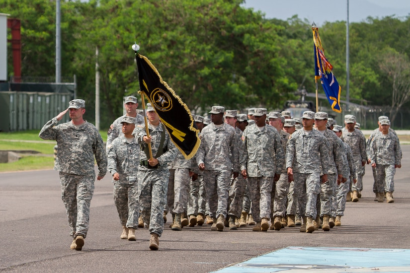 "Lt. Col. Brian Henderson, Army Forces Battalion commander, renders a salute while leading ARFOR during a ""Pass in Review"" at the Joint Task Force – Bravo change of command ceremony June 30, 2015, at Soto Cano Air Base, Honduras. ARFOR is one of five major subordinate commands at JTF-Bravo and provides a wide variety of expeditionary capabilities. (U.S. Air Force photo by Martin Chahin)"
