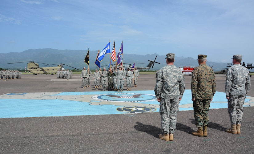 From left to right, Col. Robert Harman, Joint Task Force – Bravo incoming commander, Gen. John Kelly, U.S. Southern Command commander, and Col. Kirk Dorr, JTF-Bravo outgoing commander, salute the color guard during the change of command ceremony between Dorr and Harman June 30, 2015, at Soto Cano Air Base, Honduras. The change of command ceremony is a time-honored tradition which transfers responsibility to a new commander. (U.S. Air Force photo by Martin Chahin)