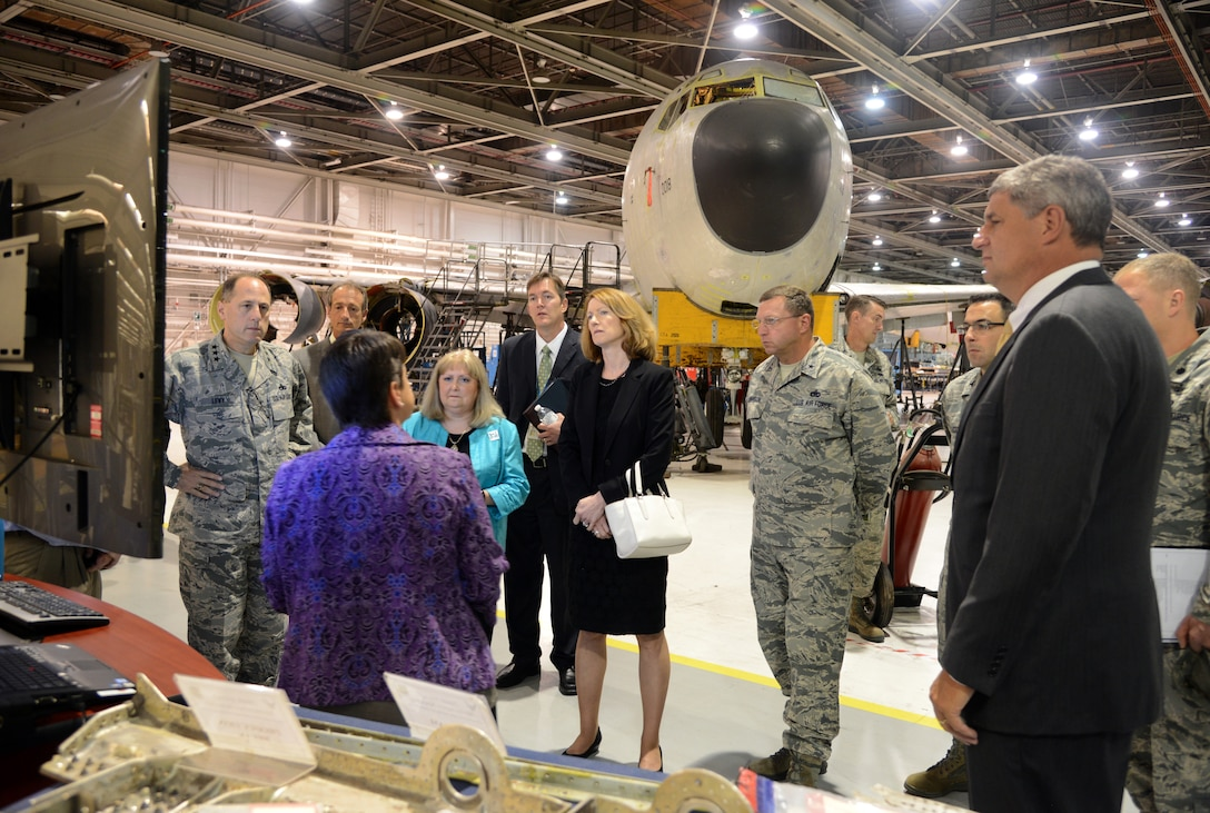 Theresa Farris, director of the 564th Aircraft Maintenance Squadron, briefs The Honorable Lisa Disbrow, the Acting Under Secretary of the Air Force and the Assistant Secretary of the Air Force for Financial Management and Comptroller, (center), and The Honorable William LaPlante, the assistant secretary of the Air Force (Acquisition) (far right), about Tinker's KC-135 programmed depot maintenance program and how utilizing the AFSC Way enables the squadron to deliver combat power to warfighter faster, with higher quality and at less cost than ever before.   Pictured, from left are, Air Force Sustainment Center Commander, Lt. Gen. Lee Levy II; Jerold Smith, Legacy Tanker Chief Engineer; Janis Wood, 76th Aircraft Maintenance Group deputy director; Kevin O'Connor, Oklahoma City Air Logistics Complex vice director; Oklahoma City Air Logistics Complex Commander, Brig. Gen. Mark Johnson; Col. William Liquori, Senior Military Assistant to the Under Secretary of the Air Force; and Lt. Col. Aaron Weiner, Military assistant to the Assistant Secretary of the Air Force (Acquisition). U.S. Air Force photo by Kelly White