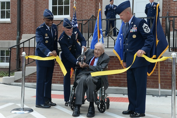 From left to right, Gen. Darren McDew, Air Mobility Command Commander, Lt. Gen. Carlton D. Everhart II, 18th Air Force Commander, Retired Col. Earl Young, and Chief Master Sgt. Robert Rodewald, 18th Air Force Command Chief cut the ribbon of the newly renovated 18th Air Force building P-4 June 29, 2015 at Scott Air Force Base. Young was the first 18th Air Force Commander when it was first activated in 1951. (U.S. Air Force photo/Airman 1st Class Kiana Brothers)