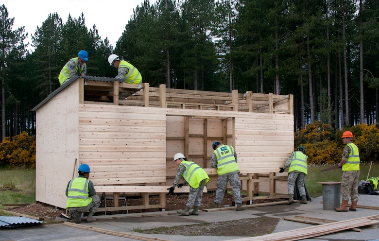U.S. Air Force Airmen of the 128th Air Refueling Wing, Wisconsin, Civil Engineering Squadron work to complete a troop shelter June 17, 2015, at Kinloss Barracks in Morayshire, Scotland, United Kingdom. The troop shelter is set to be used by the British Army for Kinloss Barracks' air support training. The building of a troop shelter was a task assigned to the airmen in support of Exercise Flying Rose. The 128th Air Refueling Wing Civil Engineering Squadron Airmen were participating in Exercise Flying Rose, an exchange exercise between the U.S. Air National Guard and British Army where forces deploy to one another's countries and work to complete construction-related tasks. (U.S. Air National Guard photo by Airman 1st Class Morgan R. Lipinski/Released)