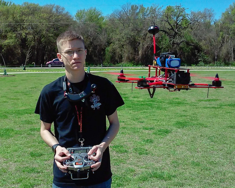 Senior Airman James Barrigar, 543rd Support Squadron, hovers his quad copter racer, checking for any abnormalities prior to a drone race March 14 in Olmos Park, San Antonio. (U. S. Air Force photo by William Belcher)