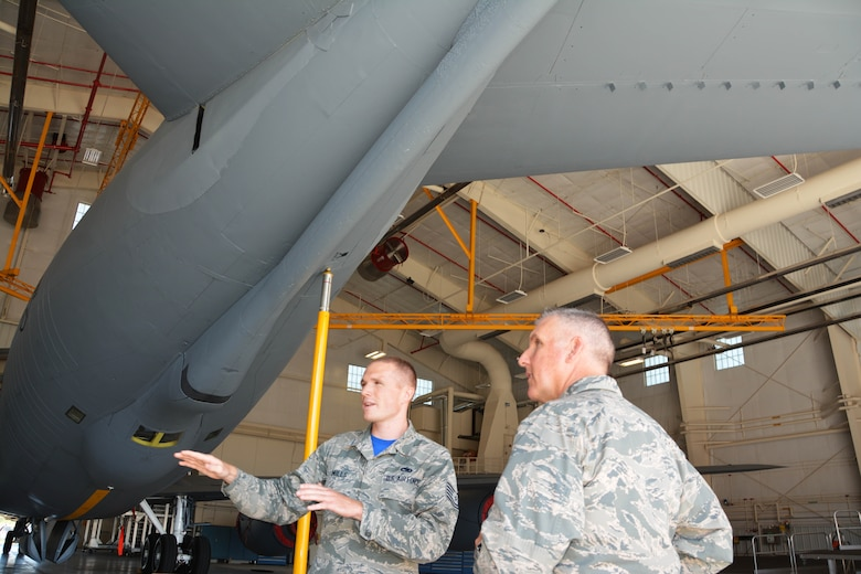 Maj. Gen. John Flournoy, 4th Air Force Commander, discusses mission requirements with Tech. Sgt. Jonathan Mills of the 507th Aircraft Maintenance Squadron June 7, 2015, at Tinker Air Force Base.  Maj. Gen. Flournoy and Command Chief Brian Wong learned about the specific missions of the 507th ARW while visiting during the June 2015 UTA. (U.S. Air Force photo/Maj. Jon Quinlan)