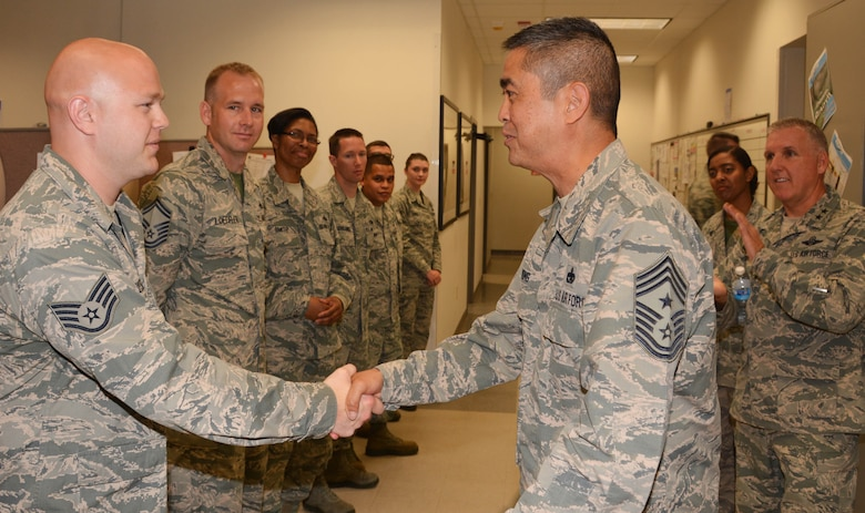 Staff. Sgt Shannon Hielscher of the 507th Maintenance Squadron shakes hands with 4th Air Force Command Chief Master Sgt. Brian Wong June 7, 2015, at Tinker Air Force Base, Okla. Maj. Gen. Flournoy and Wong learned about the specific missions of the 507th ARW during their visit over the June 2015 UTA. (U.S. Air Force photo/Maj. Jon Quinlan)
