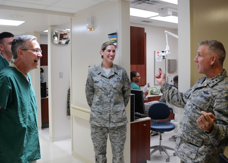 Maj. Gen. John Flournoy, 4th Air Force Commander, shares a story with Lt. Col. Randall Griffin, dental flight commander with the 507th Medical Squadron, and Tech. Sgt. Jennifer Pipkin, dental records NCOIC, June 6, 2015, at Tinker Air Force Base, Okla. Maj. Gen. Flournoy and Command Chief Brian Wong visited the 507th ARW during the June 2015 UTA to field Reservist's concerns and to learn more about the refueling wing's vital mission. (U.S. Air Force photo/Maj. Jon Quinlan)