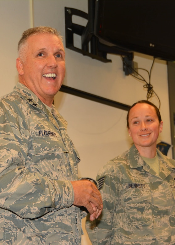Maj. Gen. John Flournoy, 4th Air Force Commander, recognizes Tech. Sgt. Heather Bennett, 507th Security Forces for her outstanding performance June 6, 2015, at Tinker Air Force Base.  Maj. Gen. Flournoy and Command Chief Brian Wong learned about the specific missions of the 507th ARW while visiting during the June 2015 UTA. (U.S. Air Force photo/Maj. Jon Quinlan)