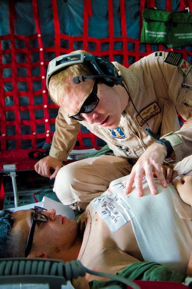 U.S. Air Force Capt. Nathaniel Krueger assigned to the 153rd Airlift Wing diagnoses a simulated casualty, June 11, 2015 while completing a casualty scenario at Davis-Monthan AFB, Tucson, Ariz. Krueger provided medical support for personnel recovery during Angel Thunder 2015. (U.S. Air National Guard photo by Tech. Sgt. John Galvin)