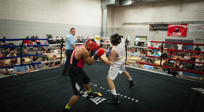 Juan Higuera, right, lands a blow on Senior Airman Martin E. Bills III, 366th Security Forces Squadron response force leader, during a fight at the Sorenson Center in Salt Lake City, March 28, 2015. Higuera began attacking once he saw Bills slow down. (U.S. Air Force photo by Airman 1st Class Jeremy L. Mosier/Released)