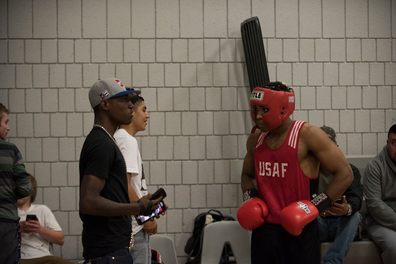 Senior Airman Martin E. Bills III, right, 366th Security Forces Squadron response force leader, speaks with Senior Airman Kamron Dungy, a fellow All Air Force Boxing Team member from Hill Air Force Base, Utah, at the Sorenson Center in Salt Lake City, March 28, 2015. Dungy boxed the previous night in the tournament and was there to record Bills' fight for him. (U.S. Air Force photo by Airman 1st Class Jeremy L. Mosier/Released)