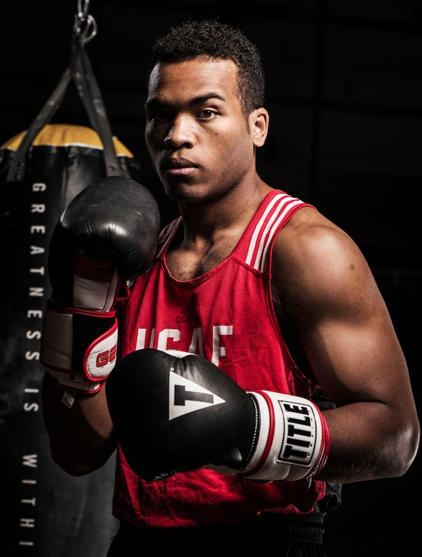 Senior Airman Martin E. Bills III, 366th Security Forces Squadron response force leader, poses for a photo at the Fitness Center Annex at Mountain Home Air Force Base, Idaho, April 18, 2015. Bills made the All Air Force Boxing Team at the beginning of the year. (U.S. Air Force photo illustration by Airman 1st Class Jeremy L. Mosier/Released)