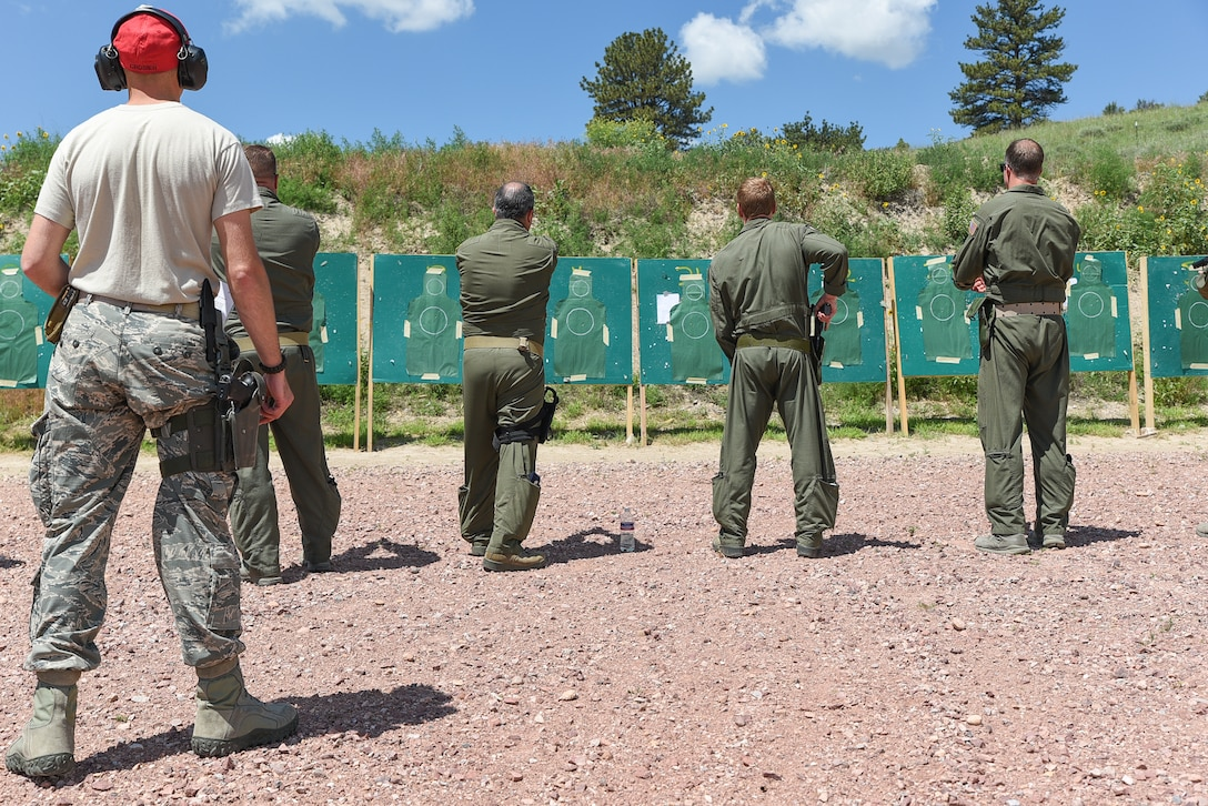 U.S. Air Force Airmen assigned to the 153rd Airlift Wing, Wyoming Air National Guard qualify with 9mm pistol, June 26, 2015, at Camp Guernsey Joint Training Center in Guernsey, Wyo. Aircrew members performed physical training, weapons qualification, water survival, combat survival, and Joint Precision Airdrop Delivery System training during four days of annual training at Guernsey. (U.S. Air National Guard photo by Master Sgt. Charles Delano)