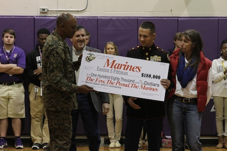 Easton Pittman, a senior from Franklinton High School, is presented an $180,000 scholarship as part of the Marine Option Naval Reserve Officer Training Corps program during an awards assembly held at Franklinton High School, Feb. 20. The scholarship being presented by the Marine Corps gives Pittman the opportunity to attend one of over 150 universities and colleges while working towards earning a commission as a 2nd Lieutenant in the Marine Corps.