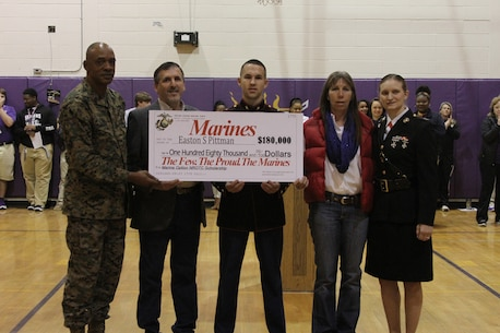 Easton Pittman, a senior from Franklinton High School, is presented an $180,000 scholarship as part of the Marine Option Naval Reserve Officer Training Corps program during an awards assembly held at Franklinton High School, Feb. 20. The scholarship being presented by gives Pittman the opportunity to attend one of over 150 universities and colleges while working towards earning a commission as a 2nd Lieutenant in the Marine Corps.