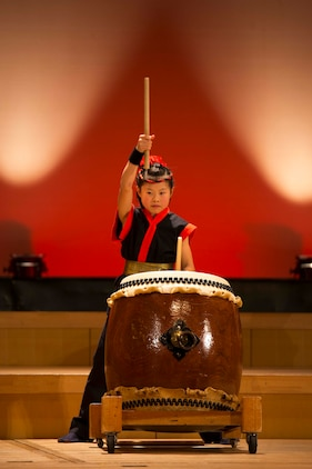 A member of the Domu, Otake City Japanese Drums Organization performs during the 2015 U.S.-Japan Friendship Concert inside the Sinfonia Iwakuni Concert Hall, Iwakuni City, Japan, Feb. 14, 2015. The purpose behind the event was to provide an opportunity for interaction between local residents and U.S. military members and build bonds through music.