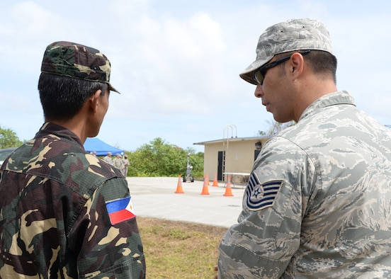 Tech. Sgt. Douglas Chadwick, 36th Civil Engineer Squadron, Explosive Ordinance Disposal flight team chief, explains EOD procedures for dealing with possible improvised explosive device threats, to Col. Roland Rivera, Armed Forces of the Philippines, office of the Surgeon General, Feb. 27, 2015, at Andersen Air Force Base, Guam.  The 36th CES Readiness and Emergency Management Flight hosted the visit and oversaw the chemical, biological, radiological, nuclear and explosive demonstration for our Philippine partners. (U.S. Air Force photo by Senior Airman Cierra Presentado/Released)