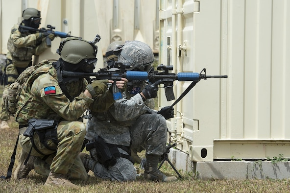 U.S. Air Force Airmen and Royal Australian air force airfield defense guards work as a team to eliminate an opposing force, while participating in a force-on-force combat scenario during exercise Cope North 15, Feb. 23, 2015, at the Commando Warrior Pacific Regional Training Center on Andersen Air Force Base, Guam. Through training exercises such as Cope North 15, the U.S., Japan and Australia air forces develop combat capabilities, enhancing air superiority, electronic warfare, air interdiction, tactical airlift and aerial refueling. The U.S. Air Force Airmen are assigned to the 736th Security Forces Squadron. (U.S. Air Force photo/Tech. Sgt. Jason Robertson)