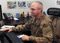 Tech. Sgt. Gregory Green analyzes spreadsheets Feb. 12, 2015, at Bagram Air Field, Afghanistan. Green is a 455th Expeditionary Force Support Squadron manpower analyst. As a one-deep analyst in the only Air Force manpower office in Afghanistan, Green provides personnel retention and reduction recommendations to commanders across the wing. (U.S. Air Force photo/Staff Sgt. Whitney Amstutz)