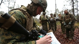 PFC Clayton Bolen, a combat engineer with 8th Engineer Support Battalion, plots points on a map before executing a patrolling exercise aboard Marine Corps Base Camp Lejeune, N.C. Feb. 26, 2015. The patrolling exercise gave the unit a sense of their proficiency level and how it can be improved in the future.