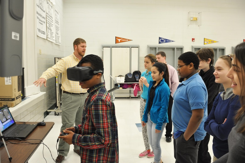 Students at Scott Middle School, Fort Knox, Ky., try on 3D goggles, which allow them to take a virtual tour of a designed school building as part of the Louisville District STEM ED initiative.