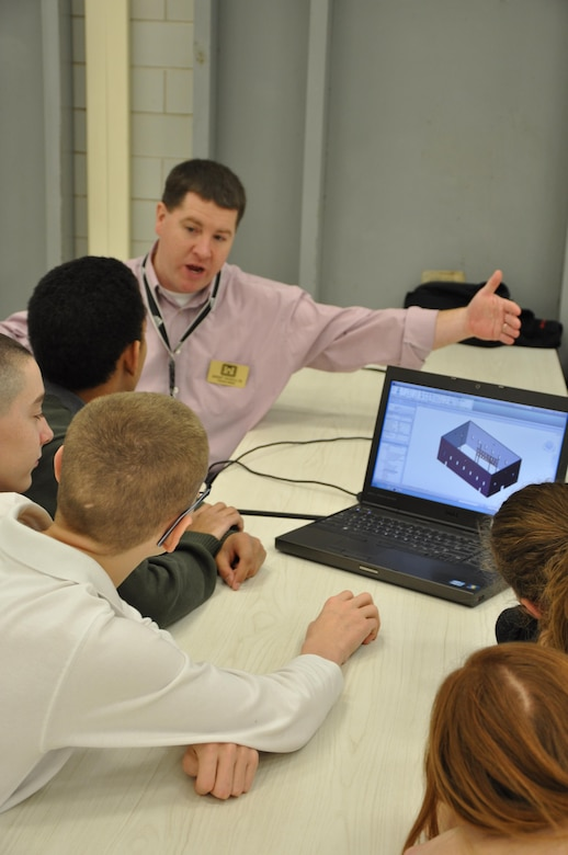 Jeremy Nichols, structural engineer, demonstrates Building Information Modeling to students at Scott Middle School, Fort Knox, Ky.