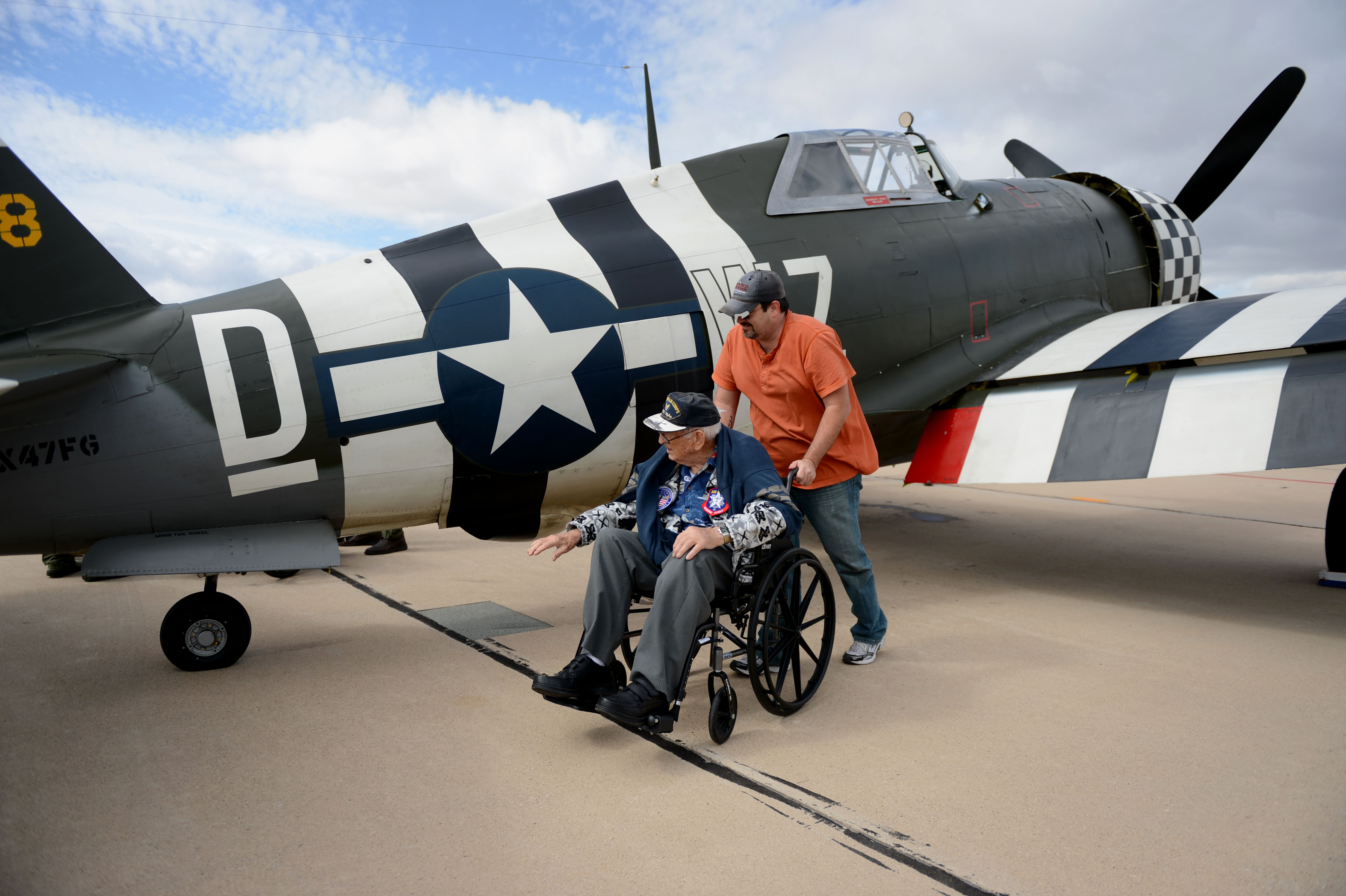 Photos retired air national guard chief warrant officer 2 robert hertel touches a p 47 thunderbolt publicscrutiny Images