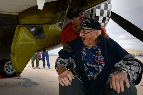 Retired Air National Guard Chief Warrant Officer 2 Robert Hertel, laughs while under the wing of a P-47 Thunderbolt during the Heritage Flight Training and Certification Course Feb. 28, 2015, at Davis-Monthan Air Force Base, Ariz. Hertel, a 92-year-old World War II veteran, was given the opportunity to visit the aircraft he used to fly. (U.S. Air Force photo/Senior Airman Jensen Stidham)