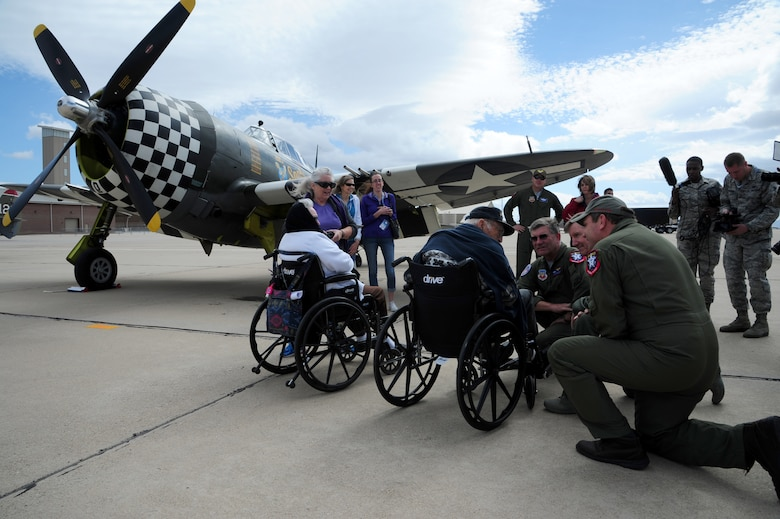 Retired Chief Warrant Officer 2 Robert Hertel, 92-year-old World War II veteran, is greeted by P-47 Thunderbolt Heritage Flight pilots, and U.S. Air Force General Hawk Carlisle, Commander of Air Combat Command, at Davis-Monthan Air Force Base, Ariz., Feb. 28, 2015. Hertel was given the opportunity to visit the aircraft he flew during WWII, up-close and personal, during the 2015 Heritage Flight Training and Certification Course. (U.S. Air Force Photo by Staff Sgt. Courtney Richardson)