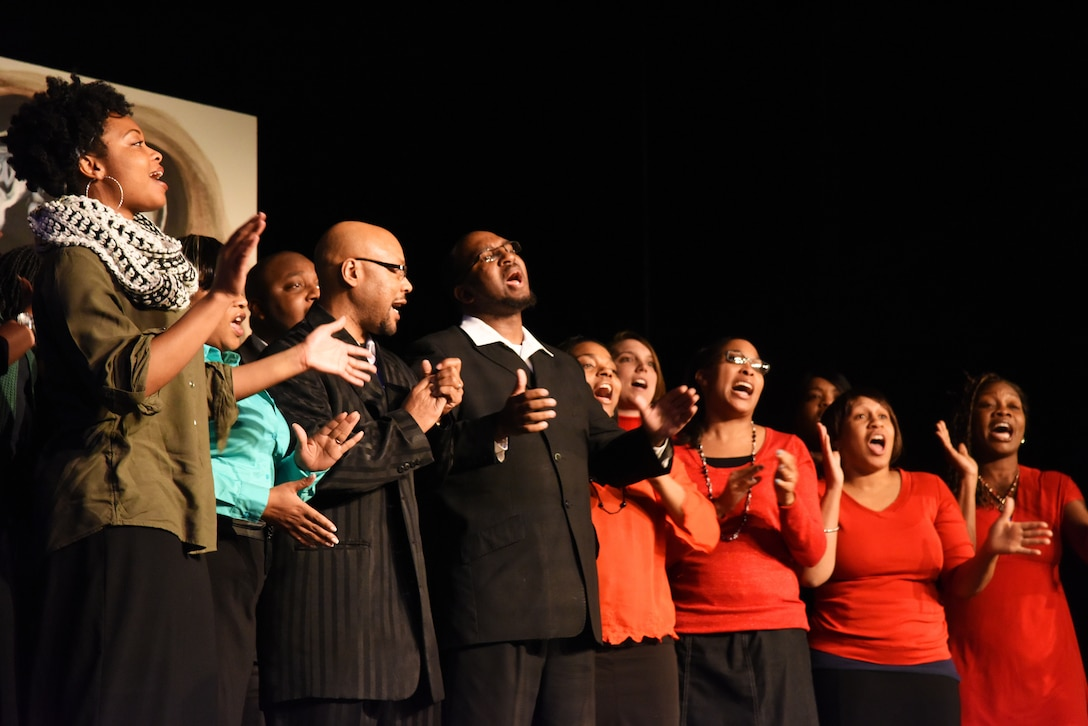 "Members of the Alexander Temple Church of God Choir sing during the opening act of the University of Great Fall's ""What Kind of History Will You Leave"" production Feb. 26. The production was hosted in celebration of Black History Month. (U.S. Air Force photo/Airman 1st Class Collin Schmidt)"