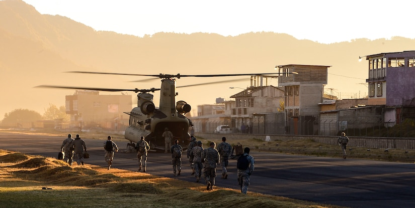 A Chinook helicopter assigned to the 1st Brigade 228th Aviation Regiment waits on the runway at the Guatemalan 12th Mountain Brigade to load personnel heading for a Medical Readiness Training Exercise in La Blanca, Guatemala, Feb. 26, 2015. During the two-day exercise, the JTF-Bravo team and preventative medicine specialists from the Guatemalan Ministry of Health educated, screened and treated over 1,200 patients. (U.S. Air Force Photo/Tech. Sgt. Heather Redman)