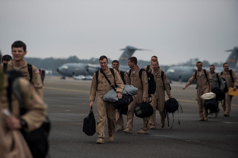 Airmen from the 16th Airlift Squadron arrive home, March 2, 2015, at Joint Base Charleston, S.C, during their redeployment from Southwest Asia. Aircrews from the 16th AS flew 1,902 sorties, logged more than 4,400 combat flying hours and airlifted more than 71 million pounds of cargo and 17,500 personnel during their two-month deployment.  (U.S. Air Force photo/Senior Airman Jared Trimarchi)