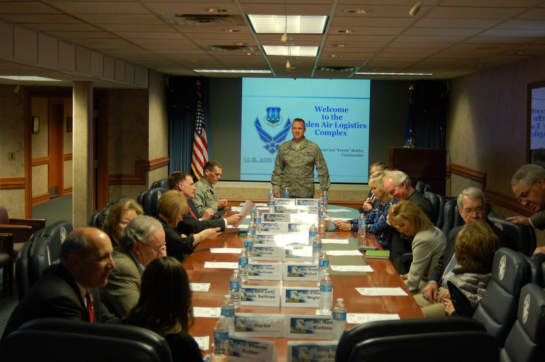 Brig. Gen. Carl A. Buhler, Ogden Air Logistics Complex commander briefs community leaders from the Utah Defense Alliance and the Top of Utah Military Affairs Committee. Attendees received a close-up look Feb. 13 at progress in F-22 Raptor maintenance here. (Air Force photo)