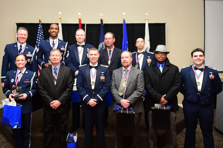 Award winners representing units from all over Buckley Air Force Base stand together at Team Buckley's Annual Awards ceremony Feb. 27, 2015, at the Summit Event Center in Aurora, Colo. The award winners were recognized for their performance in each of their respective disciplines. (U.S. Air Force photo by Airman 1st Class Luke W. Nowakowski/Released)